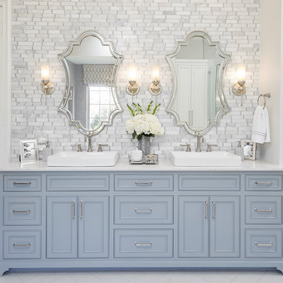 Inspiration for a timeless master white tile and gray tile white floor bathroom remodel in Dallas with beaded inset cabinets, blue cabinets, white walls and a vessel sink