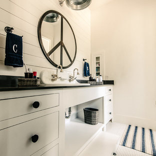 Bathroom - coastal bathroom idea in Austin with a trough sink, flat-panel cabinets, white cabinets and black countertops