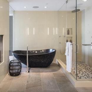 Ispirazione per una grande stanza da bagno padronale contemporanea con ante lisce, ante nere, vasca freestanding, doccia ad angolo, lavabo da incasso, top in acciaio inossidabile, porta doccia a battente, due lavabi e mobile bagno incassato