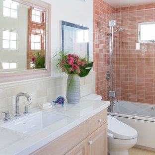 Elegant 3/4 orange tile beige floor bathroom photo in Los Angeles with raised-panel cabinets, light wood cabinets, white walls, an undermount sink and white countertops