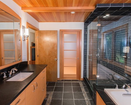 example of a trendy black tile and matchstick tile bathroom design in new york with an - Matchstick Tile Home Design