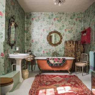 This is an example of a shabby-chic style master bathroom in Other with a claw-foot tub, green walls, a pedestal sink and white floor.