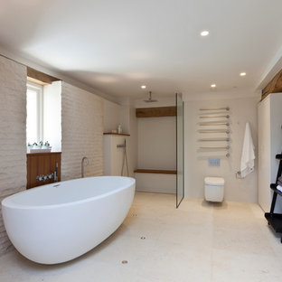 Cottage bathroom photo in London with a wall-mount toilet and beige walls