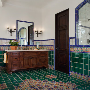 Alcove shower - mediterranean multicolored tile alcove shower idea in San Francisco with furniture-like cabinets, dark wood cabinets and white walls