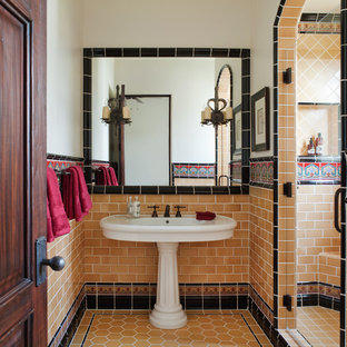 Inspiration for a mediterranean orange tile bathroom remodel in San Francisco with a pedestal sink and white walls