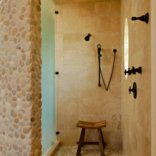 Inspiration for a tropical pebble tile floor bathroom remodel in Charleston