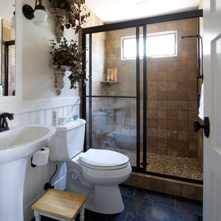 Pebble tile floor in the shower grounds this earthy bathroom remodel.