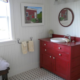 Bathroom - mid-sized farmhouse 3/4 porcelain floor bathroom idea in Other with recessed-panel cabinets, red cabinets, a one-piece toilet, white walls, a drop-in sink, wood countertops and red countertops