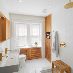 Inspiration for a mid-sized scandinavian bathroom in Philadelphia with a trough sink, flat-panel cabinets, medium wood cabinets, an open shower, white tile, an open shower and white floor.