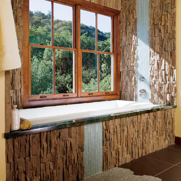 Pella® Architect Series® double-hung windows bathe a room in natural light