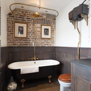 Victorian ensuite bathroom in London with recessed-panel cabinets, dark wood cabinets, a claw-foot bath, a shower/bath combination, a two-piece toilet, white walls, medium hardwood flooring, a built-in sink, wooden worktops, brown floors and an open shower.