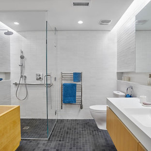 Bathroom - contemporary 3/4 white tile gray floor bathroom idea in Other with flat-panel cabinets, light wood cabinets, white walls, a console sink and a hinged shower door