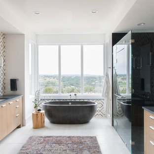 Transitional master black tile white floor bathroom photo in Austin with flat-panel cabinets, brown cabinets, multicolored walls, an undermount sink and a hinged shower door