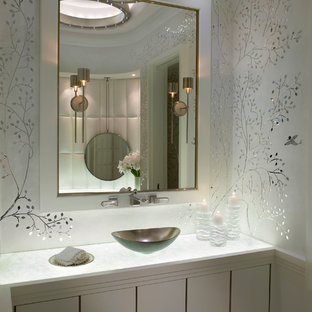 Bathroom - mid-sized contemporary 3/4 white tile marble floor and white floor bathroom idea in Miami with flat-panel cabinets, white cabinets, white walls, a vessel sink and marble countertops