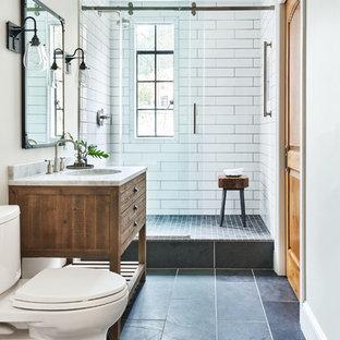 ポートランドの小さいトランジショナルスタイルのおしゃれなバスルーム (浴槽なし) (家具調キャビネット、ヴィンテージ仕上げキャビネット、分離型トイレ、白いタイル、セラミックタイル、白い壁、コンソール型シンク、大理石の洗面台、グレーの洗面カウンター) の写真