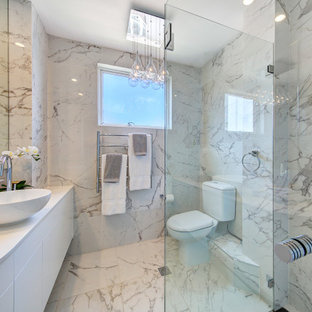 Inspiration for a large contemporary 3/4 bathroom in Sydney with flat-panel cabinets, white cabinets, a corner shower, a two-piece toilet, gray tile, porcelain tile, porcelain floors, a vessel sink, grey floor, white benchtops, a single vanity and a floating vanity.