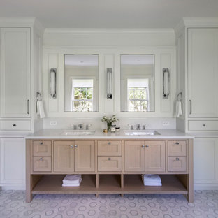 Example of a beach style mosaic tile floor, white floor and double-sink bathroom design in Providence with recessed-panel cabinets, light wood cabinets, white walls, an undermount sink, white countertops and a built-in vanity
