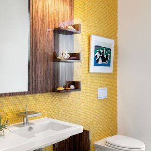 Small trendy 3/4 yellow tile terrazzo floor and multicolored floor bathroom photo in Tampa with a wall-mount toilet, a wall-mount sink and white walls