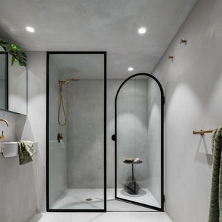 Small modern master bathroom in Sydney with flat-panel cabinets, grey cabinets, an alcove shower, gray tile, grey walls, concrete floors, concrete benchtops, grey floor, a hinged shower door and grey benchtops.