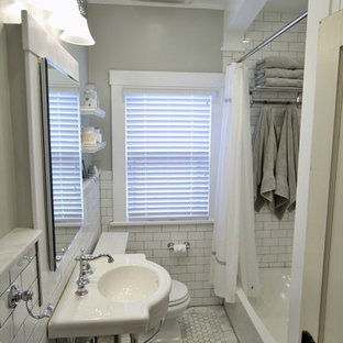 This is an example of a small arts and crafts bathroom in Denver with an alcove tub, white tile, porcelain tile, a console sink and a shower curtain.
