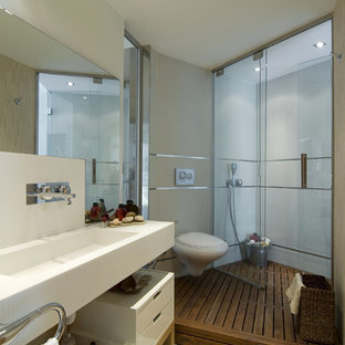 Example of a minimalist bathroom design in Other with a wall-mount toilet