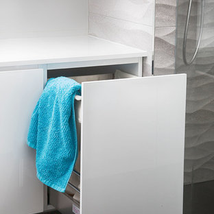 Inspiration for a mid-sized modern gray tile and porcelain tile ceramic floor doorless shower remodel in Perth with white cabinets and white walls