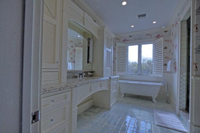 Tropical Bathroom by Eskuche Design