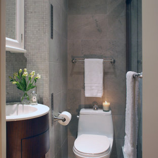 Inspiration for a transitional mosaic tile bathroom remodel in New York with a console sink
