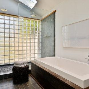 Bathroom - contemporary master gray tile and pebble tile bathroom idea in New York with white walls