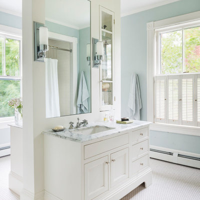 Inspiration for a large timeless master mosaic tile floor and white floor bathroom remodel in Boston with recessed-panel cabinets, white cabinets, blue walls, marble countertops and an undermount sink