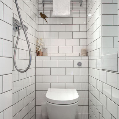 Bathroom - transitional white tile and subway tile bathroom idea in London with a one-piece toilet
