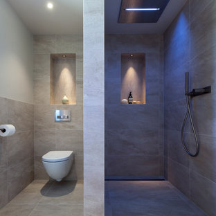 Inspiration for a contemporary gray tile bathroom remodel in Manchester with a wall-mount toilet and gray walls