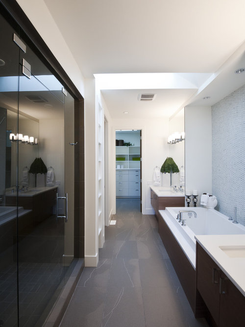 Contemporary blue tile bathroom idea in Calgary