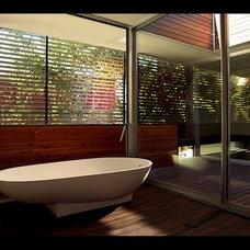 Modern Bathroom by M. J. Neal Architects, LLC.