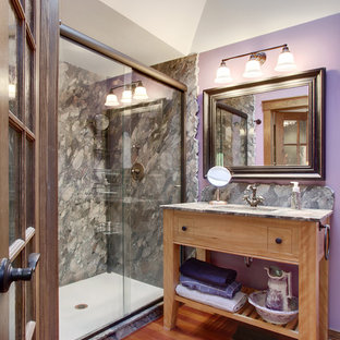 Traditional bathroom in Seattle with medium wood cabinets, an alcove shower, gray tile, purple walls, medium hardwood floors and open cabinets.