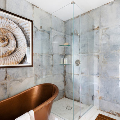 Mid-sized transitional master blue tile and porcelain tile marble floor and white floor bathroom photo in New York with blue walls and a hinged shower door