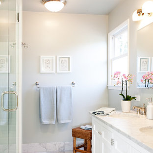 Inspiration for a transitional white tile alcove shower remodel in San Francisco with an undermount sink, shaker cabinets and white cabinets