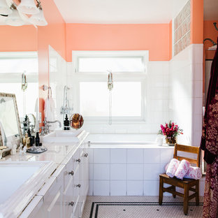 Inspiration for an eclectic ceramic tile mosaic tile floor bathroom remodel in Los Angeles with raised-panel cabinets, white cabinets, pink walls and a drop-in sink