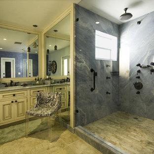 Example Of A Tuscan Blue Tile And Marble Tile Bathroom Design In Miami With  Raised