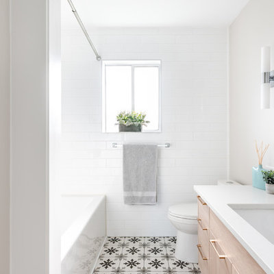 Transitional master porcelain tile and gray floor bathroom photo in Other with flat-panel cabinets, light wood cabinets, an undermount sink, quartz countertops and white countertops