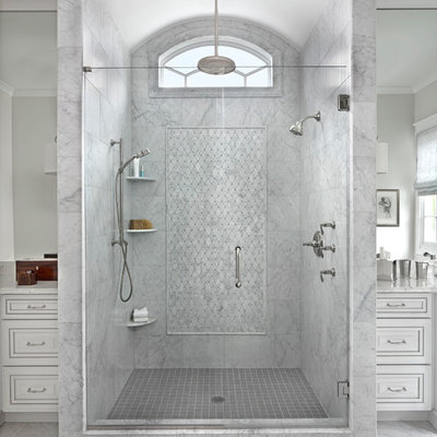 Wet room - large transitional master marble floor wet room idea in Detroit with a hinged shower door, raised-panel cabinets, white cabinets and an undermount sink