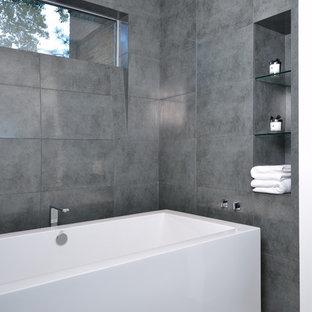 Freestanding bathtub - modern gray tile freestanding bathtub idea in Houston