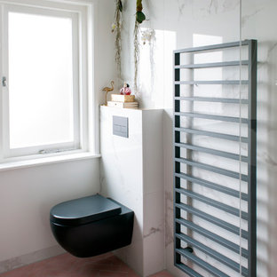 Inspiration for a small eclectic master white tile and marble tile cement tile floor and pink floor doorless shower remodel in Amsterdam with flat-panel cabinets, black cabinets, a wall-mount toilet, white walls, a drop-in sink and granite countertops