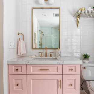 Mid-sized 1960s master white tile and subway tile mosaic tile floor and white floor corner shower photo in New York with beaded inset cabinets, a two-piece toilet, white walls, a drop-in sink, a hinged shower door and white countertops