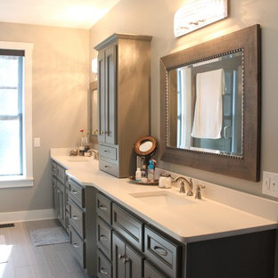 Drop-in bathtub - mid-sized transitional master porcelain tile and gray floor drop-in bathtub idea in Nashville with an undermount sink, quartz countertops, recessed-panel cabinets and gray cabinets