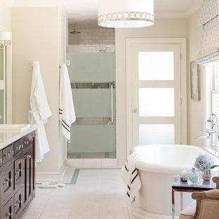 Ispirazione per una stanza da bagno padronale classica di medie dimensioni con vasca freestanding, lavabo da incasso, ante con riquadro incassato, ante in legno bruno, doccia alcova, piastrelle bianche, piastrelle in ceramica e pareti beige