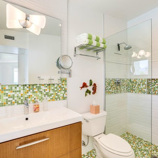 Inspiration for a 1950s 3/4 multicolored tile and mosaic tile mosaic tile floor and multicolored floor bathroom remodel in Los Angeles with flat-panel cabinets, medium tone wood cabinets, a two-piece toilet, white walls and an integrated sink