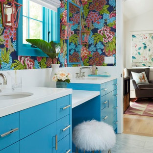 Design ideas for a mid-sized transitional kids bathroom in San Francisco with flat-panel cabinets, turquoise cabinets, a curbless shower, a one-piece toilet, white tile, ceramic tile, white walls, marble floors, an undermount sink, engineered quartz benchtops, white floor, a hinged shower door and white benchtops.