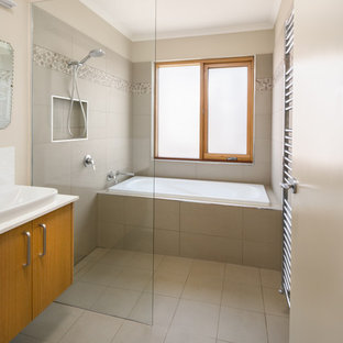 Mid-sized contemporary master wet room bathroom in Other with light wood cabinets, a drop-in tub, beige tile, engineered quartz benchtops, an open shower, white benchtops, flat-panel cabinets, cement tile, beige walls, cement tiles, a drop-in sink and beige floor.