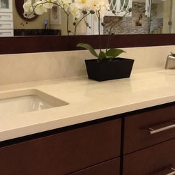 Pompeii Quartz Barcelona - This product is installed at TNT Cabinetry, Naples. This material is a great alternative to marble.